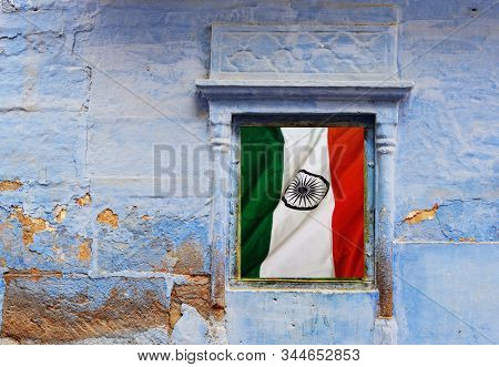 Blue Wall With Hanging Indian National Flag Of Ancient Building In Agra, India.