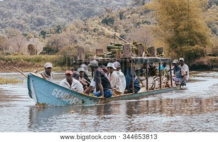 Madagascar October 19.2016: Overcrowded And Overloaded Boat Taxi With People And Cargo On The River