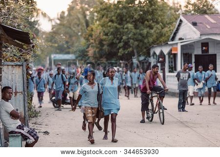 Maroantsetra, Madagascar October 19.2016: Malagasy Students Dressed In School Uniforms In The Evenin