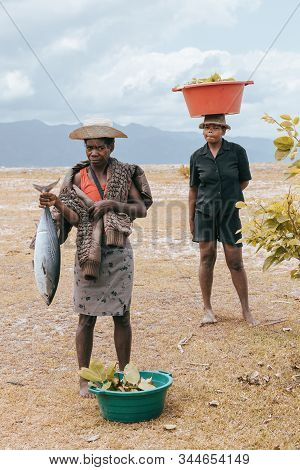 Maroantsetra, Madagascar October 19.2016: Aboriginal Madagascar Woman Shows Today Catch, A Big Fish.