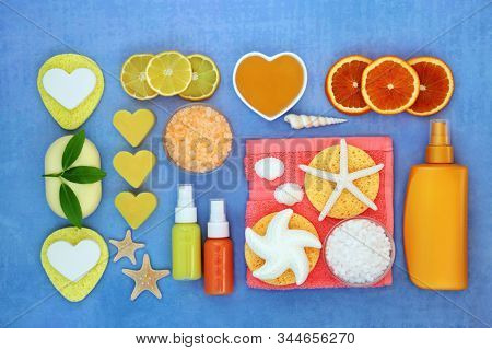 Skin care beauty treatment with citrus fruit and exfoliation, moisturising and cleansing products. Natural health spa concept. Flat lay.