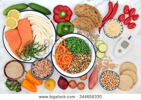 Low GI health food for diabetics with blood sugar testing monitor with foods high in vitamins, minerals, anthocyanins, antioxidants, smart carbs and omega 3. Below 55 on the GI index. Top view.