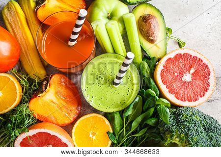 Green And Orange Detox Smoothie In Glass. Ingredients For Detox Smoothie Background. Healthy Food Co