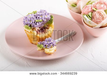 Flower Cupcakes And Cup Of Tea On White Background. Beautiful Sponge Cup Cakes Decorated With Butter