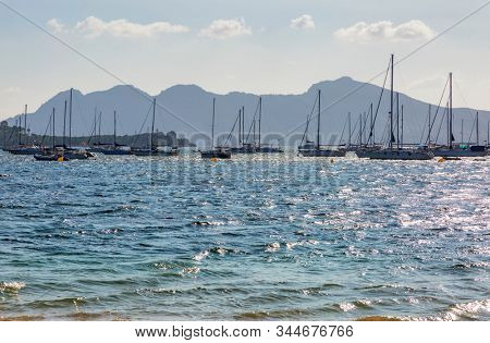 Yachts at early morning in the harbor of Port de Pollenca, Mallorca, Spain