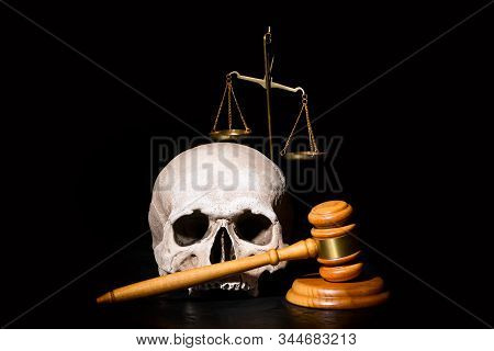 Legal Law, Justice And Murderment Concept. Wooden Judge Gavel Hammer Near Human Skull And Balance Br