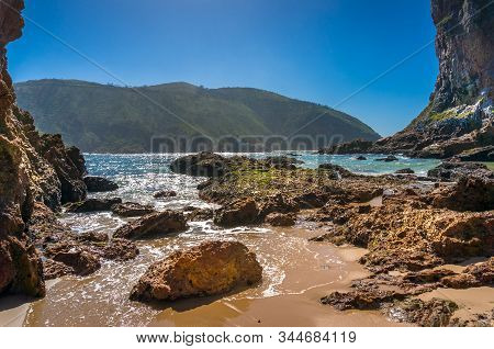 Beautiful Coastal Landscape With Rocks And Green Hills. Summer Beach Landscape. South African Coastl