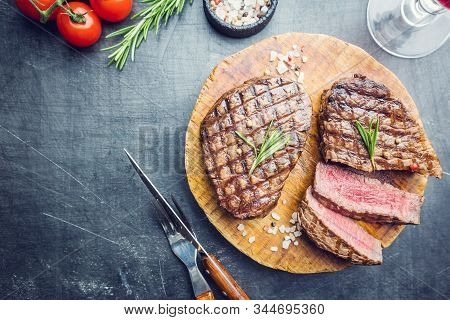 Grilled Marbled Meat Steak Filet Mignon With Seasonings. Juicy Beef Steak On Cutting Board, Top View