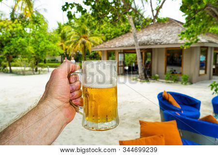 A Glass Of Cold Beer On A Hot Day At The Beach, On The Shores Of A Tropical, Fabulous Sea. Maldives