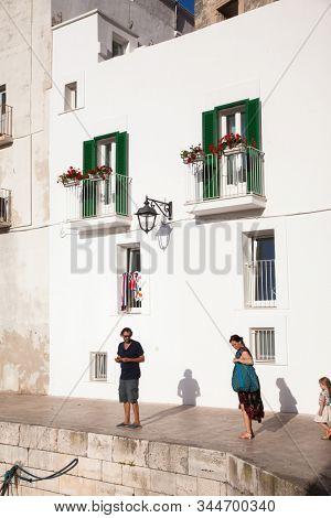 MONOPOLI, ITALY - JULY 2019: traditional houses in Monopoli  Italy
