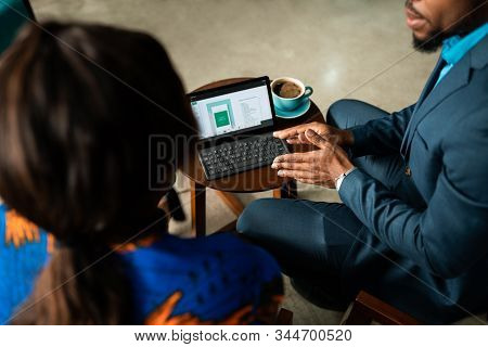 Closeup Of Business Meeting Consultation By Black African Financial Adviser.
