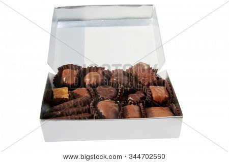 Chocolate Candy. Valentines Day gift of a Box of assorted chocolates. Isolated on white. Room for text. Clipping Path. Everyone loves chocolate candy. Enjoy the holidays with Chocolate.