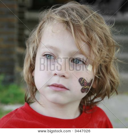 Portrait Of Five Year Old Boy With Butterfly Tattoo And