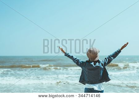 Copy Space Of Woman Rise Hand Up On Blue Sky At Tropical Beach And Island Background. Freedom And Tr