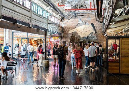 New York City, Usa - September 21, 2019: People Walking Along Shops Inside The Historic Chelsea Mark
