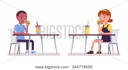 School Boy And Girl Eating Lunch At Table. Cute Small Children With Snack, Active Young Kids, Smart