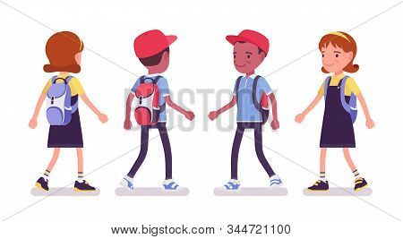 School Boy And Girl In A Casual Wear Walking. Cute Small Children With Rucksack, Active Young Kids,