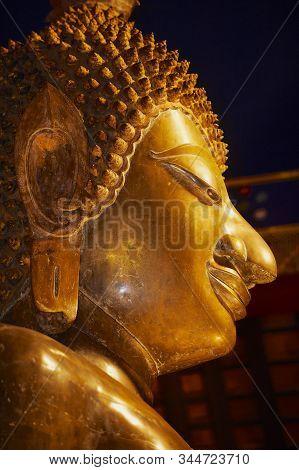 Vientiane, Laos - April 22, 2012: Face Of The Golden Buddha Statue At The Wat Ong Teu Mahavihan (tem