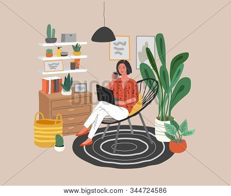 Cute Woman Sitting On Chair With Laptop In Cozy Scandinavian Home Interior. Girl Working At Home In