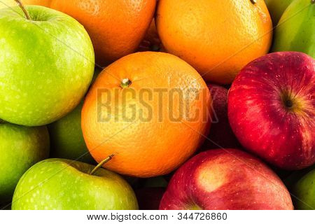 Green Apple And Orange And Red Apple And Banana Are Mixed Tasty Fruit Composition On  Background Fru