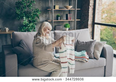 Profile Photo Of Amazing White Haired Aged Granny Holding Tidy Pullover Hands Put It In Stack Spring