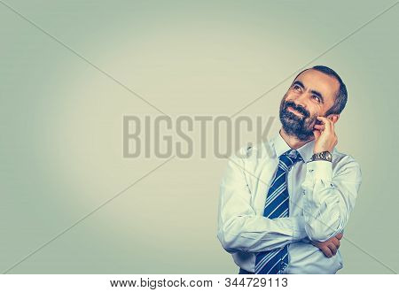 Daydreaming. Smiling Isolated Elegant Bearded Man Looking Up Touch Face With Fingers Having A Daydre