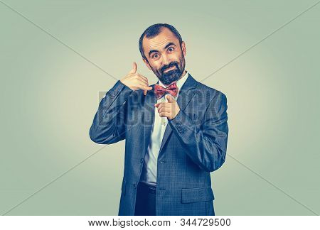 Standing Bearded Businessman Shows Call Me Gesture And Pointing Towards Camera Hands Gesture. Isolat