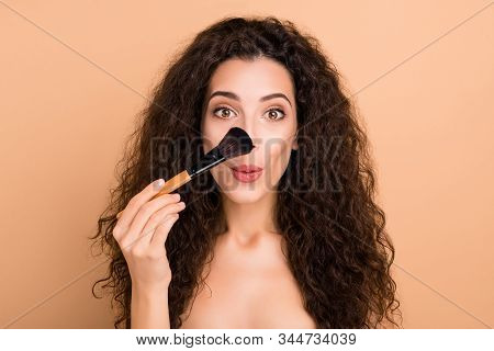 Close-up portrait of her she nice charming cute lovely attractive lovable magnificent cheerful cheery funky playful childish wavy-haired girl highlighter bb cc cream isolated on beige background poster