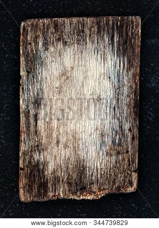 Old Wooden Board On The Dark Background Closeup