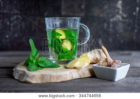 Fresh Mint - Ginger Tea With Mint Leaves, Ginger Bulb And Rock Sugar On Wood