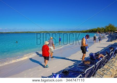 Half Moon Cay, Bahamas - December 02, 2019: People At Beach On Half Moon Cay Island At Bahamas. Blue