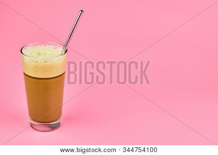 Traditional Green Ice Coffee Frappe In Glass With Metal Straw Isolated On Pink Background With Copy