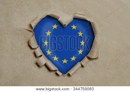 3d illustration. Heart shaped hole torn through paper, showing European Union flag