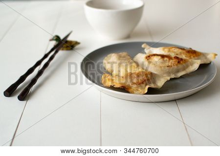 Jiaozi Traditional Swaddling During Chinese New Year Celebration. A Hearty And Tasty Dish. Close-up