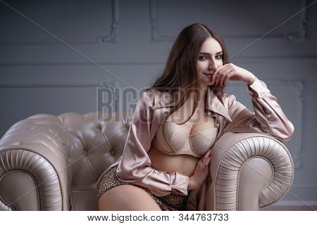 Concept: Fashion, Sensuality, Tenderness, Attraction. Beautiful Woman With Long Hair Sensual Beige L