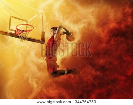Basketball player players in action. Basketball concept on red smoke background