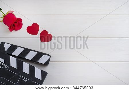 Cinema On Valentine's Day. Movie Advertisement. Cinema Clapper Board With Hearts And A Rose On A Whi