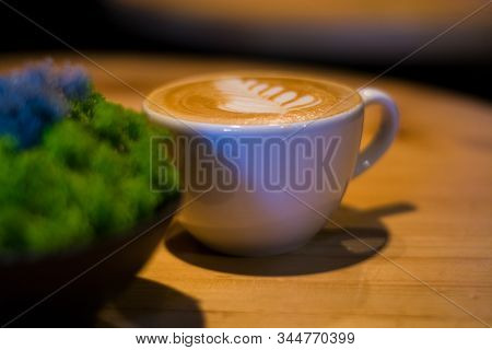 White Ceramic A Cup Of Cappuccino With Picture, Latte Art In Coffee Shop. The Morning Drink. Fresh C