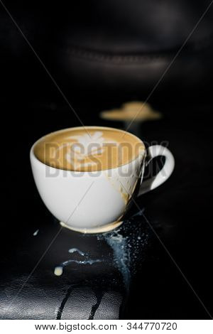 White Ceramic A Cup Of Cappuccino With Picture Spilled, Latte Art In Coffee Shop. The Morning Drink.