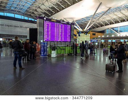 Ukraine, Boryspil - October 22, 2019: Passengers At The Information Desk In Boryspil International A