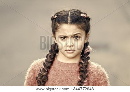 Suspicious Look. Kanekalon Strand In Braids Of Child. Braided Hairstyle Concept. Girl With Braided H