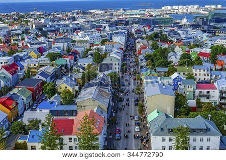 Reykjavik, Iceland - August 26, 2019 Colorful Red Blue Green Houses Cars Shopping Streets Harbor Rey