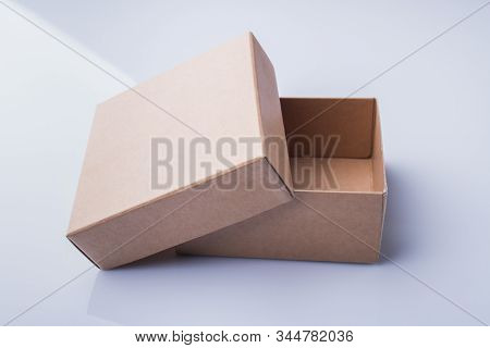 Uncovered Small Cardboard Box. Two Pieces Of A Corrugated Container.