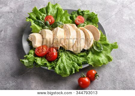 Boiled Chicken Fillet With Lettuce And Tomatoes On Plate