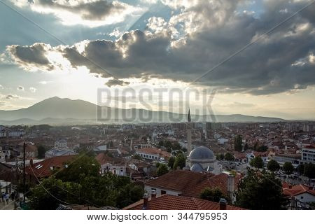 Panorama Of The City Center Of Prizren, Kosovo, With Minaret Ofthe Sinan Pasha Mosque At Sunset. Pri