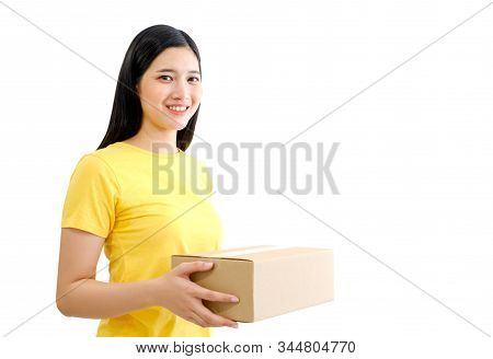 Young Thai Lady Entrepreneur Holding The Box. Isolated On White Baclground With Clipping Path. Selli