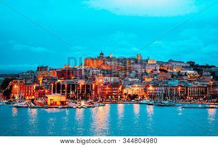 Cagliary Cityscape And Architecture With Mediterranean Sea On Sardinia Italy Reflex