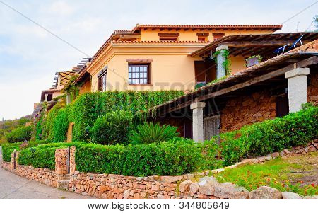 Scenery With House And Cottage In Capo Coda Cavallo Reflex