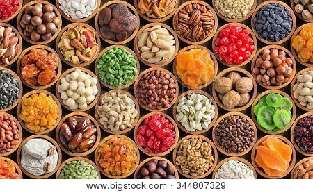 Assorted Nuts And Seeds, Dried Fruit With Berries. Collage Healthy Food Background.