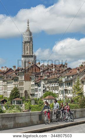 Bern, Swiss - May 24 : Tourists Visiting The Old Medieval City, Bern, Switzerland By Bicycle On May